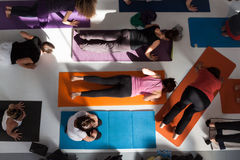 Top view of people at Yoga Festival in Milan, Italy. MILAN, ITALY - OCTOBER 11: People take a class at Yoga Festival 2013, event dedicated to yoga, meditation Royalty Free Stock Photography