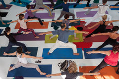 Top view of people at Yoga Festival in Milan, Italy. MILAN, ITALY - OCTOBER 11: People take a class at Yoga Festival 2013, event dedicated to yoga, meditation Royalty Free Stock Photos