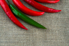 Top view of peppers: chili and paprika pepper on. Top view of chili peppers: chili and paprika pepper on linen cloth background with emty space Stock Images