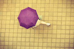 Top view person walking on street with umbrella Stock Images