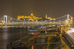 Top view from the Pest side of the Elisabeth Bridge and Buda castle background in Budapest at night. Royalty Free Stock Images