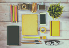 Top view photo of blank notebook, old camera and school supplies Royalty Free Stock Photography