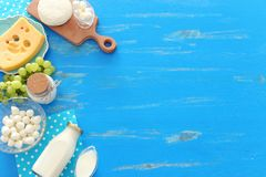 Top view photo of dairy products over blue wooden background. Symbols of jewish holiday - Shavuot stock photos