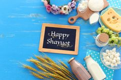 Top view photo of dairy products over blue wooden background. Symbols of jewish holiday - Shavuot royalty free stock photo