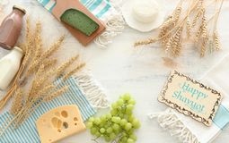 Top view photo of dairy products over white wooden background. Symbols of jewish holiday - Shavuot stock images