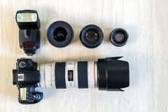 Top view of photo DSLR camera, camera lenses and a flash Stock Photo
