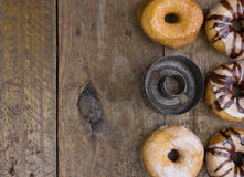 Top view photo of five doughnuts and a vintage cutter on rustic Stock Photography