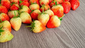 A heap of red strawberry, Fresh berry fruit on wooden background with copy space stock images