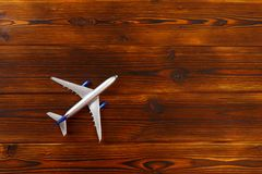 Top view photo of toy airplane over wooden background. Image royalty free stock images