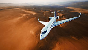 Top View Photo White Luxury Generic Design Airplane.Private Jet Cruising High Altitude, Flying Over Mountains.Empty Blue Royalty Free Stock Photos