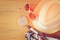 Top view photo of woman accessories , different objects on wooden background. instagram style filtered image Stock Photography