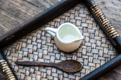 Top view photography of mini jar of syrup and wooden spoon all t. Ogether put in bamboo tray Stock Photo
