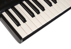 Top view of piano keyboard with white and black keys on white background Royalty Free Stock Images