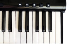 Top view of piano keyboard with white and black keys on white background Royalty Free Stock Photos