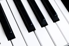 Top view of piano keys. Close-up of piano keys. Close frontal view. Piano keyboard with selective focus. Diagonal view. Piano keyb royalty free stock photos