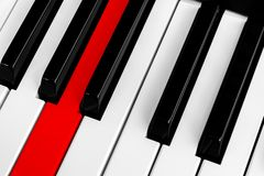 Top view of piano keys with one red button. Close-up of piano keys. Close frontal view. Piano keyboard with selective focus. Diago. Nal view. Piano keyboard royalty free stock images