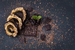 Top view on pieces of a chocolate cake and chocolate with mint l royalty free stock photos