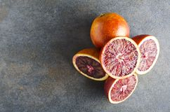 Top view of pile of blood orange and halves of it.Empty space for your design stock images