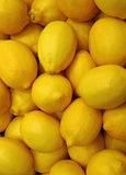 Top View of Pile of Vibrant Yellow Lemons, Vertical Photo. For Background Stock Photography
