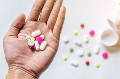 Top view of the pills on the hand and white background Stock Image