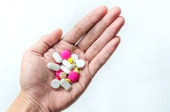 Top view of the pills on the hand and white background Royalty Free Stock Photos