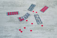 Top view of the pills on the white background, The drug and capsule pills on the floor, Pile of the drug and pills on the white ba royalty free stock photography