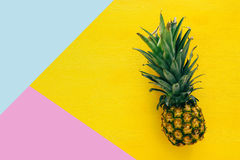 Top view of Pineapple on colorful table. Summer and tropical concept royalty free stock photos
