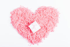 Top view of a pink heart and a decorative box with a gift and a Stock Image