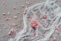 Top view of pink heart shaped soap on white gauze. On marble surface Stock Images