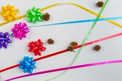 A top view of multi-color gift wrap bow with matching ribbons royalty free stock photo