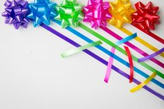 A top view of multi-color gift wrap bow with matching ribbons stock photography