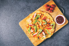 Top view of pizza with seafood paprika and tomatoes in vintage retro style Royalty Free Stock Image
