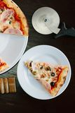 Top view of pizza slice on white plate over table. Top view of pizza slice on white plate over table stock image
