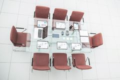 Top view - a place for business meetings in the modern conference room. on the desktop,. Spread out financial charts,calculators and laptop. the photo is a stock photos