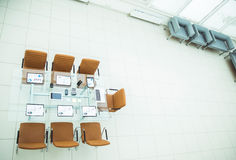 Top view - a place for business meetings in the modern conference room. on the desktop,. Spread out financial charts,calculators and laptop. the photo is a royalty free stock photography