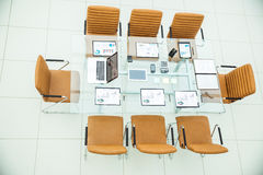 top view - a place for business meetings in the modern conference room. on the desktop, royalty free stock image