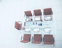 Top view - a place for business meetings in the modern conference room. on the desktop,. Spread out financial charts,calculators and laptop. the photo is a stock photo