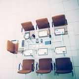 Top view - a place for business meetings in the modern conference room. on the desktop,. Spread out financial charts,calculators and laptop. the photo is a royalty free stock images