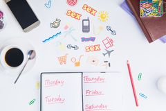 Top view Planning Organizer mark up for a week and colourful icons of actions on the working place with stationery and coffee. Cre. Ative concept image of Royalty Free Stock Photo