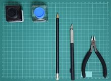 Top view Plastic model tool kit ink, art knife, cutting pliers on Cutting plate and copy space stock image