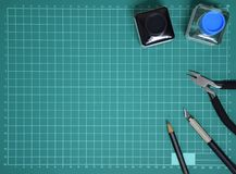 Top view Plastic model tool kit ink, art knife, cutting pliers on Cutting plate and copy space royalty free stock photos