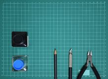 Top view Plastic model tool kit ink, art knife, cutting pliers on Cutting plate and copy space stock photo