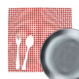 Top view plate with fork and spoon on tablecloth for food servin Royalty Free Stock Photography
