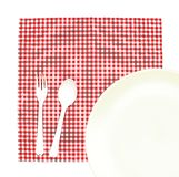 Top view plate with fork and spoon on tablecloth for food servin Stock Photography