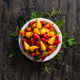 Top view of plate with orange, red and yellow hot chili peppers, Stock Photos