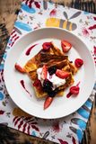 Slices of  finnish pancake served with cream and fruits. Top view of a plate with slices of  finnish pancake served with cream and fruits- pannukakku Royalty Free Stock Photos