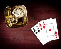 Top of view of poker cards near wiskey glass. Top of view of poker playing cards near wiskey glass on old wood table Royalty Free Stock Image