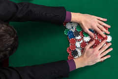 Top view of poker player hands on gambling table. Top view of poker player hands on poker table stock photo