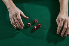 Top view of poker player hands on gambling table. Top view of poker player hands on poker table royalty free stock photography