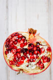Top view of pomegranate fruit divided on halves. Top view of pomegranate fruit divided on halves stock photos